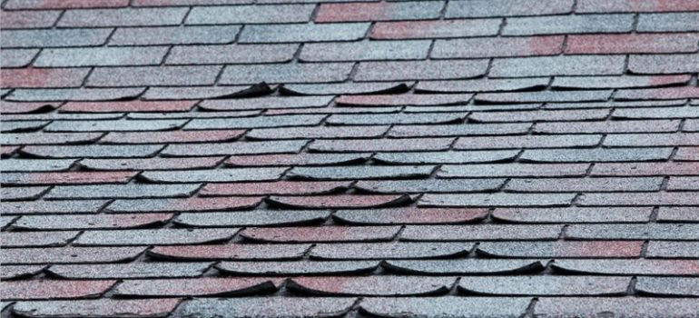 Shingles on a roof in need of repair.