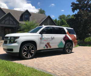 The Ft Lauderdale branch of RoofClaim has their vehicle in front of a newly installed roof.