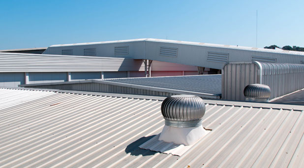 A commercial building with a newly installed metal roof.